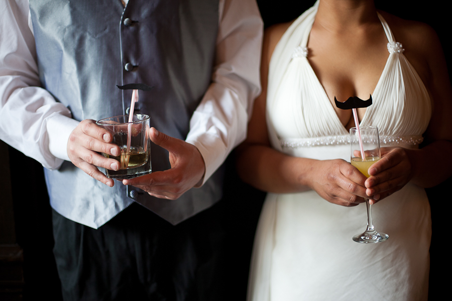 Bunn Salarzon - bride and groom holding drinks with mustache straws
