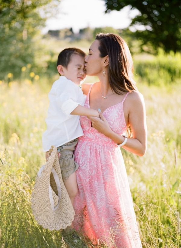 Bunn Salarzon - beautiful young mom kissing son on forehead