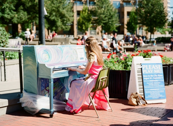 Bunn Salarzon - fair elf playing piano in the park