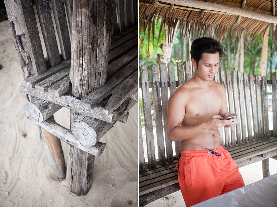 Bunn Salarzon - cute boy texting on phone at beach in philippines